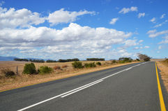 Long road  with yellow line Royalty Free Stock Image