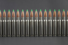 Long Row of Ballistic Tip Rifle Rounds. Row of Ballistic Tip Rifle Rounds. Close up Royalty Free Stock Photo