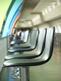 Long Row of Bar Stools Royalty Free Stock Photo