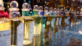 Long Row of Beautiful Perfume Bottles on Display Royalty Free Stock Images