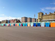 Long row of colourfully painted wooden beach huts. On Brighton and Hove promenade Stock Images