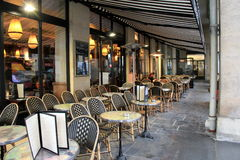 Long row of comfortable tables and chairs at outdoor cafe,Paris France,2016 Royalty Free Stock Photography