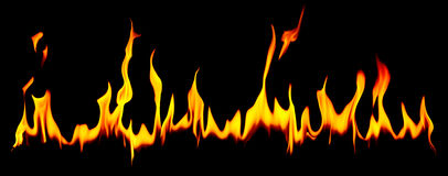 Long row of flames over dark background Royalty Free Stock Images