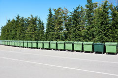 Long row of garbage cans in park Royalty Free Stock Images