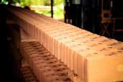 Interlocking bricks. A long row of interlocking bricks Stock Photos