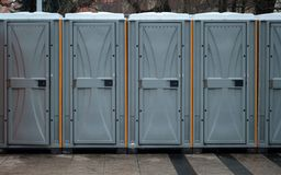 Long row of mobile toilets outside in the city. Bio toilets outdoors.  stock photo