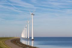 Long row off shore wind turbines in the Dutch sea Stock Photo
