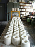Long row of pottery jars in manufacturing workshop. Diminishing perspective Stock Photos