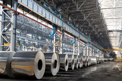 Long row of rolls of aluminum Stock Images