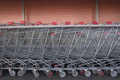 Long row of shopping trolleys Stock Photography