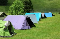 Long row of tents to sleep during the summer camp Stock Photography