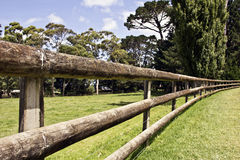 Long rustic fence made of logs Royalty Free Stock Photography
