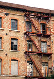Long rusty fire escape in industrial building abandoned Stock Images