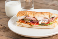 Long sandwich with chicken ham and pork ham. Royalty Free Stock Image