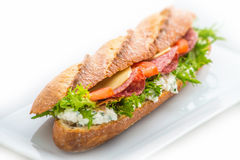 Long sandwich with ham, cheese, tomatoes and lettuce.  on white background Royalty Free Stock Photography