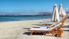 Long Sandy Beach. And deckchairs near Chania, Crete island royalty free stock photography