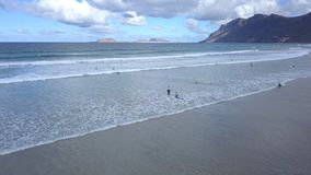 Caleta de Famara with surfers, Lanzarote stock photo