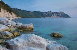 The long sandy beach of portonovo, monte conero, italy Stock Photos