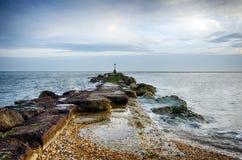 Sea Groyne. A long sea groyne on the beach at Hengistbury Head near Christchurch in Dorset Royalty Free Stock Images