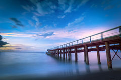 Long sea pier at sunset Stock Photography