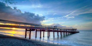 Long sea pier at sunset Royalty Free Stock Images