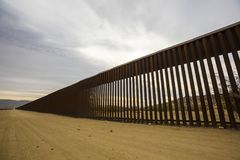 Long Section of United States Border Wall With Mexico royalty free stock photos
