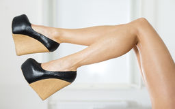 Long and sexy legs in extreme platform shoes Royalty Free Stock Photos