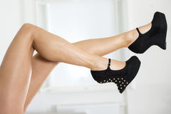 Long and sexy legs in extreme platform shoes with wedge style Royalty Free Stock Photo