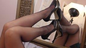 Free Long Sexy Legs On Mirror Stilettos Black Stockings Royalty Free Stock Photos - 197259108