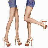Long sexy woman legs.beauty female legs in high heels.jeans skir Stock Images