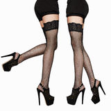 Long sexy woman legs in stockings.beauty female legs in high hee. Fashion photo of long sexy woman legs in stockings.beauty female legs in high heels.black short Royalty Free Stock Photography