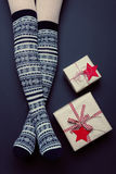 Long sexy woman legs with xmas over the knee socks. Christmas holiday concept Royalty Free Stock Photo