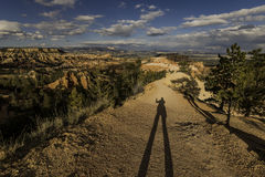 Long shadow of human on trail of Bryce Canyon Royalty Free Stock Image