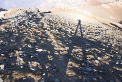 The long shadow of the man on the rocky slopes of the Tien Shan Stock Photos