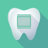 Long shadow tooth with   a photographic 35mm film strip. Illustration of a long shadow  tooth with   a photographic 35mm film strip Stock Photography