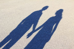 Long shadow of two lovers Stock Photos