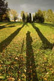 Long shadows. Photographer and his long shadow stock images