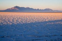 Bonneville Salt Flats Graham Peak Sunset Mountain Range. Long shadows fall on the Salt Flats near West Wendover Nevada on the border with Utah stock images