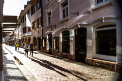Long shadows of pepople on the evening street Royalty Free Stock Images