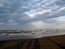 Long shadows on sandy beach royalty free stock photos