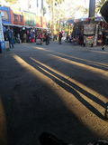Long Shadows of the visitors at the Los Angeles Co Stock Photo