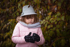Long shaggy girl in jacket, gray scarf and fedora hat Stock Photos