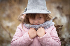 Long shaggy girl in jacket, gray scarf and fedora hat Royalty Free Stock Photo