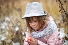 Long shaggy girl in jacket, gray scarf and fedora hat Stock Photo