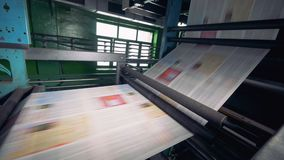 Newspaper printing equipment works at a plant, close up. stock footage