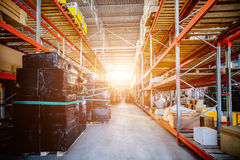 Long shelves with a variety of boxes and containers. Stock Image