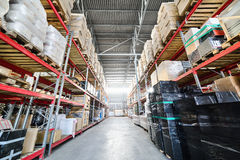 Long shelves with a variety of boxes and containers. Royalty Free Stock Image