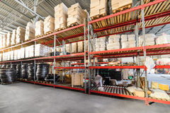 Long shelves with a variety of boxes and containers. Royalty Free Stock Photo