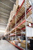 Long shelves with a variety of boxes and containers. Stock Photos