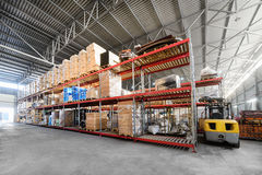 Long shelves with a variety of boxes and containers. Warehouse industrial and logistics companies. Long shelves with a variety of boxes and containers Royalty Free Stock Photo
